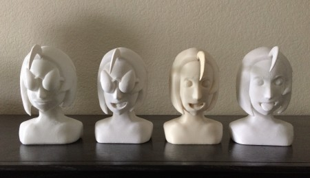 { Group photo of some of the finished busts. From left to right: bust 2, 5, 7, 9. The hair flippy for bust 7 had to be painted to match the ivory color. Luckily, my mom painted a fence in the yard a very similar color. }