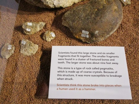 { Caption: One of the displays showing rock fragments that fit together. }